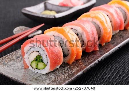 Sushi roll : Row of salmon & tuna sushi rolls with chopsticks