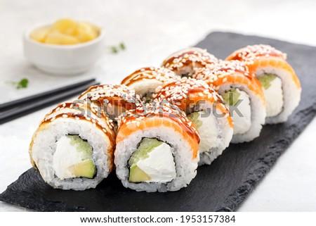 Sushi roll set with salmon,ell, avocado, cucumber,cream cheese, sesame and sauce. Sushi menu. Japanese food. Stock fotó ©