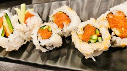 Sushi Roll Spicy Tuna and Cucumber with Ginger Wasabi Close Up Top View