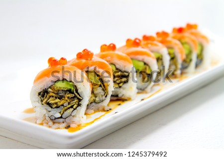 Sushi roll, Sushi fusion, Maki fusion is Japanese Food. Fresh and delicious sushi.Salmon, Salmon skin, Avocado and salmon caviar roe served on a plate. Most Americans people like sushi.