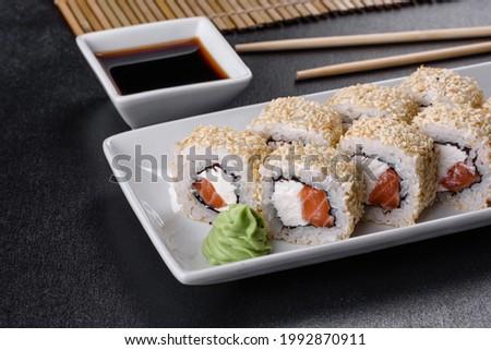 Sushi roll sushi with prawn, avocado, cream cheese, sesame. Sushi menu. Japanese food
