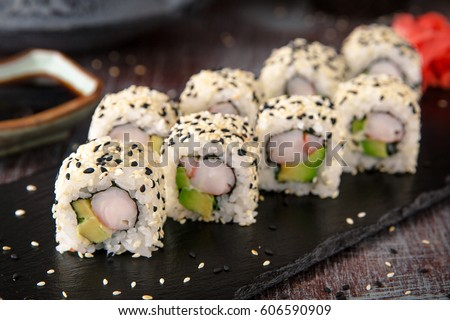 Sushi roll sushi with prawn, avocado, cream cheese, sesame. Sushi menu. Japanese food.