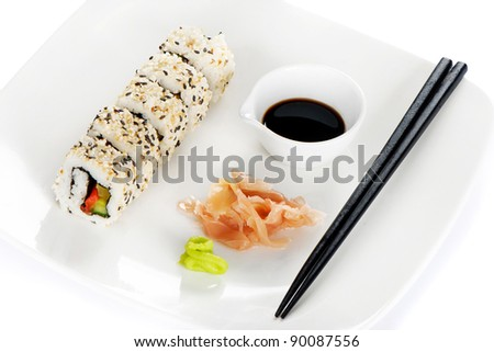 Sushi  roll, wasabi and ginger on the white plate