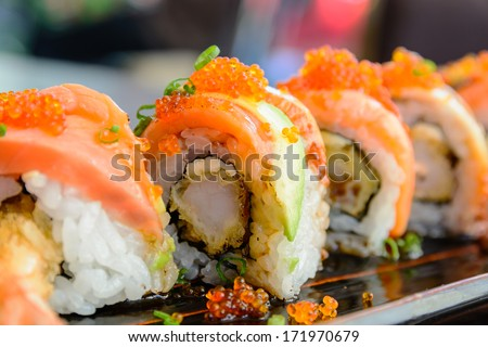 Sushi roll with salmon and shrimp tempura