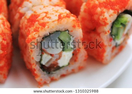 Sushi Rolls Close Up Isolated on White Plate. Japanese Healthy Food, Asian Traditional Roll Sushi Set with Rice, Avocado, Shrimp, Tuna, Cream Cheese and Salmon. Delicious Sushi Rolls Picture