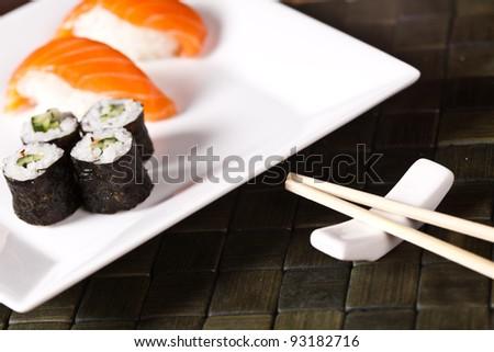Sushi rolls closeup with chopsticks