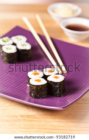 Sushi rolls closeup with chopsticks