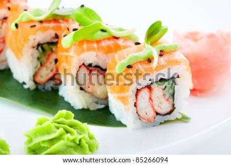 Sushi rolls closeup with fresh salmon on white background stock