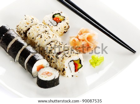 Sushi  rolls, wasabi and ginger on the white plate