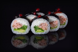 Sushi Rolls with fresh tuna fish and cheese inside. Roll  on glass black background. Sushi menu. Japanese food.