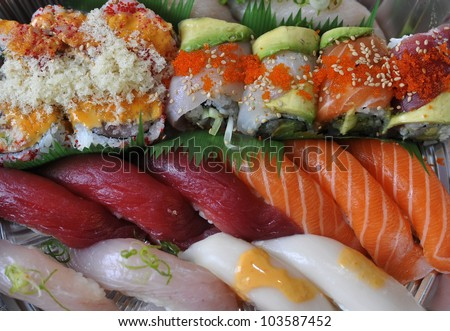 Sushi, sashimi, rolls on tray closeup - traditional japanese food