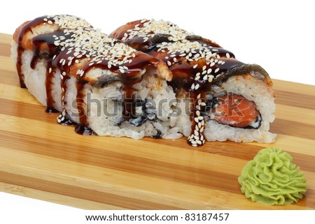 Sushi sauce and sesame seeds on a wooden tray