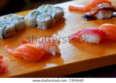 Sushi served on a wooden board - stock photo