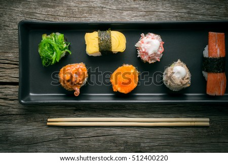 Sushi Set and sushi rolls served on wood table.