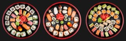 Sushi Set nigiri, rolls and sashimi served in traditional Japan black Sushioke round plate. On dark background