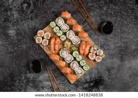 Sushi set of nigiri and maki rolls served on wooden board. Japanese food. Top view  #1418248838