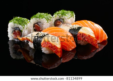Sushi set on black background - stock photo
