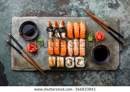 Shutterstock Sushi Set sashimi and sushi rolls served on stone slate