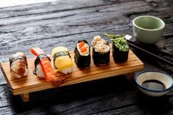 Sushi Set served on dark wooden table