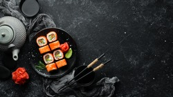 Sushi set with caviar, avocado and salmon. Asian cuisine. Top view. Free space for your text.