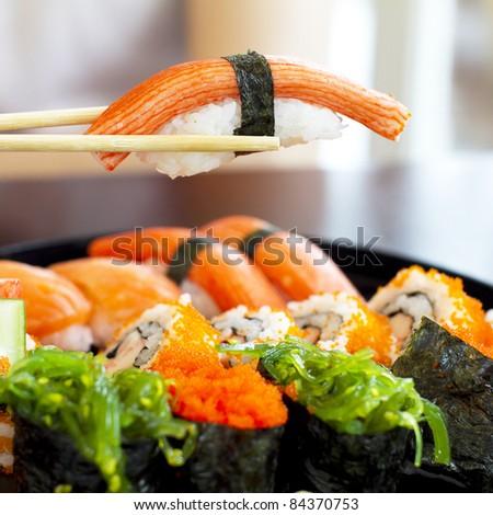 sushi set with chopstick over the sushi set