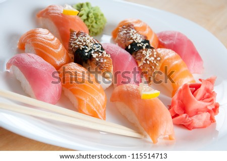 Sushi set with chopsticks on a white plate, horizontal shot