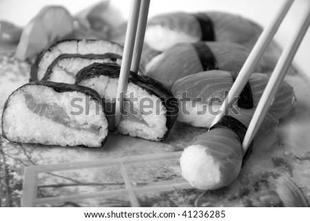 Sushi With Chopsticks  Sushi with chopsticks against white background.