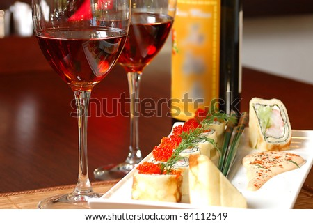 sushi with red wine on a table at restaurant