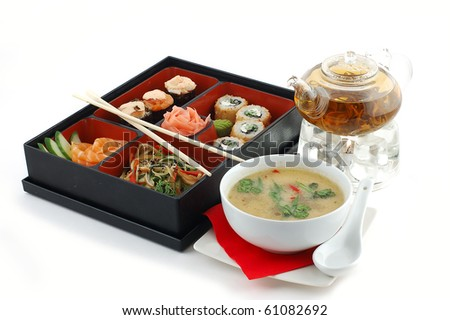 Sushi with tea and soup on a white background