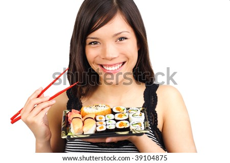 Sushi. Woman eating take away sushi closeup. Beautiful smiling model isolated on white background.