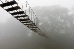 Suspended bridge in the fog