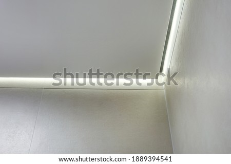 suspended ceiling with halogen spots lamps and drywall construction in empty room in apartment or house. Stretch ceiling white and complex shape. Stock photo ©