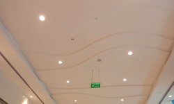 Suspended Gypsum false ceiling and coves are white painted and installed for an commercial shopping mall interiors and Industry comes under lot of lucrative designs and views