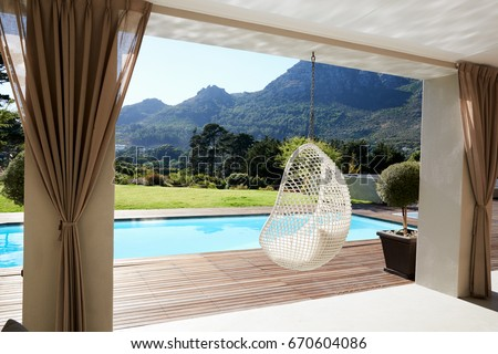 Suspended Seat Next To Decking Around Outdoor Swimming Pool Foto d'archivio ©