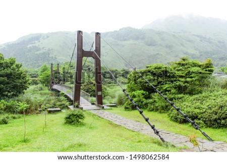 Suspension bridge across the valley in Yang Ming Shan national park, Taiwan  Stok fotoğraf ©