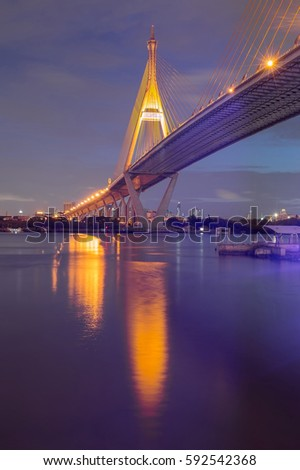 Suspension bridge cross over Bangkok city river night view #592542368