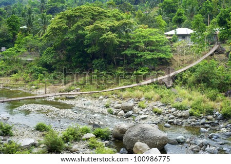 Suspension bridge in a small village. Cordillera mountains, Philippines