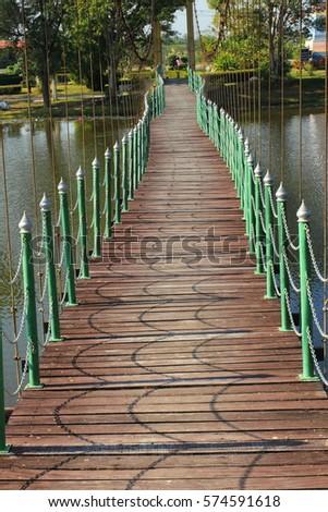 Suspension bridge in public park Thailand #574591618