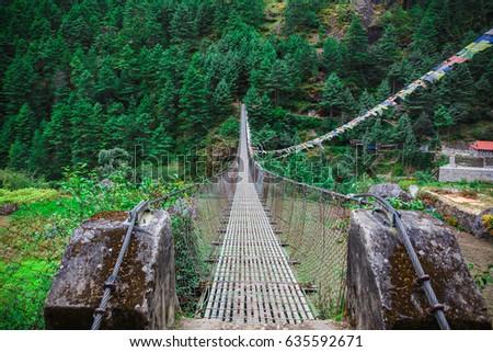 Suspension bridge in the mountains #635592671