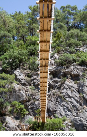 suspension bridge in the mountains, view from below