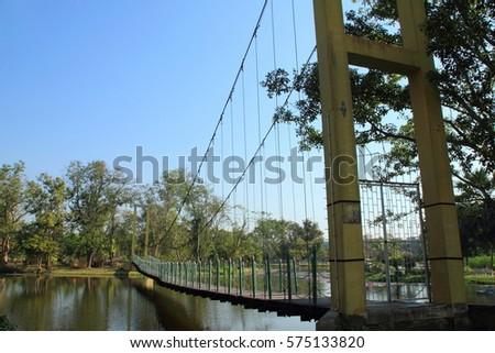 Suspension bridge in the public park Thailand #575133820