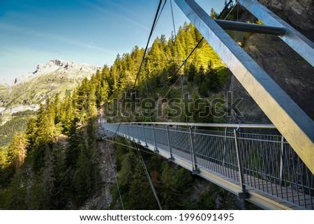 Suspension bridge on Bisse du Ro walking trail near Crans Montana in canton of Valais in Switzerland Photo stock ©