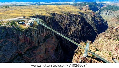 Suspension Bridge Over Deep Canyon - Wide Aerial View Of Royal Gorge Bridge In Colorado, USA #740268094