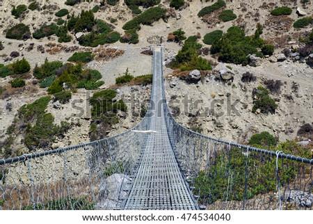 Suspension bridge over Khola Ghyanchang river #474534040