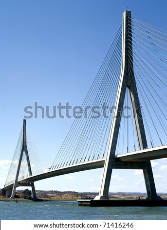 Suspension bridge over the river between Spain and Portugal #71416246