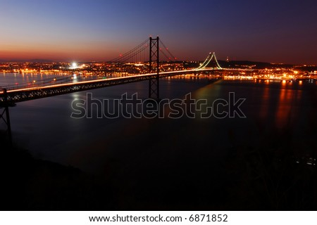 Suspension Bridge over the Tagus River, in Lisbon at dusk