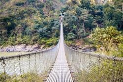 Suspension bridge over the Trishuli River in the Himalayas in Kurintar, Nepal