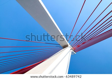 Suspension bridge with cables reaching to the deck of the bridge from the columns #63489742
