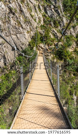 Suspension bridges in the Loriguilla reservoir. Ruta de los Pantaneros in the town of Chulilla in the Valencian community. Spain Foto stock ©
