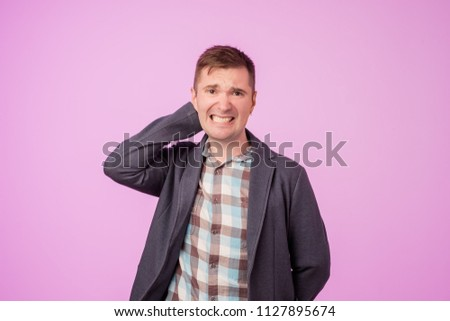 Suspicious middle aged european man looks doubtfully, being indecisive, makes grimace, tries to find solution. He is not sure in decision. Negative facial expressions concept. #1127895674
